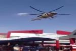 بالفيديو.. طيار عراقي يحلق بمروحية عسكرية فوق جامعة في بغداد لتحية حبيبته