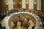 المعارضة السورية ترجئ قرارها حول المشاركة بمحادثات جنيف وتلمح لأجواء إيجابية