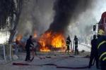 مقتل 14 عراقياً بتفجير سيارة شمال بغداد