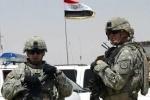 قوات أمريكية تساعد الجيش العراقي في مد جسر على نهر دجلة لاستعادة الموصل