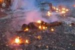 """صورة مؤلمة لجثة سوري تحترق جراء القصف الروسي.. و""""الدخيل"""" يصفها بالـ""""هولوكوست"""""""
